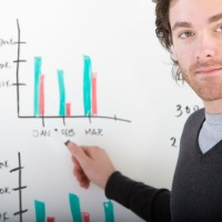 Man presenting graphs