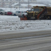 Picture courtesy of: Barclay Pollak   A snow plow lays down salt in Madison, Wis. in the hours leading up to winter storm Rex.
