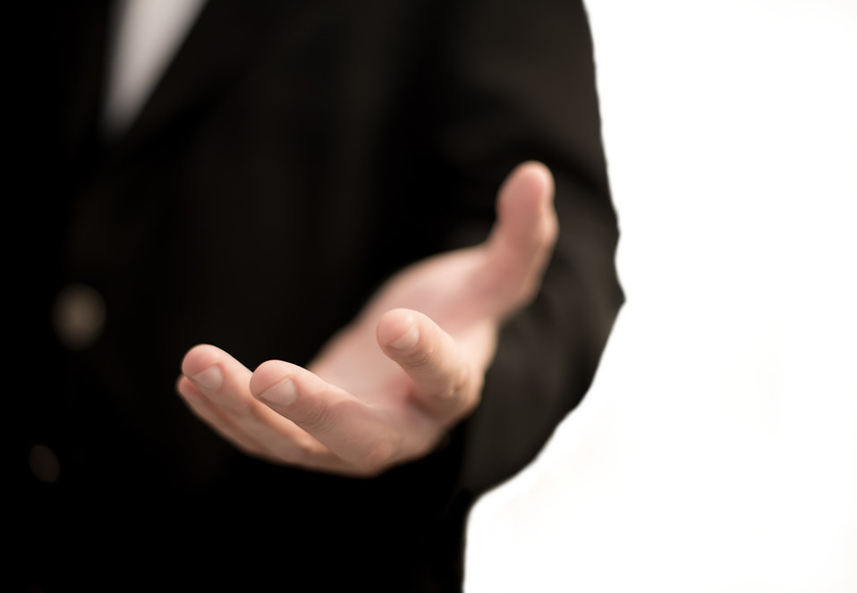 """""""Business man hand"""" by kev-shine is licensed under Creative Commons Attribution 2.0"""