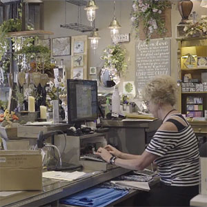 Small business owner talks business internet image